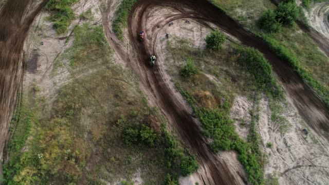 cross country motorcycling track above aerial view - motocross video stock e b–roll