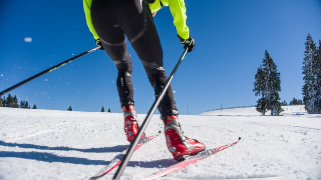 cross country skier skate skiing uphill - sci video stock e b–roll