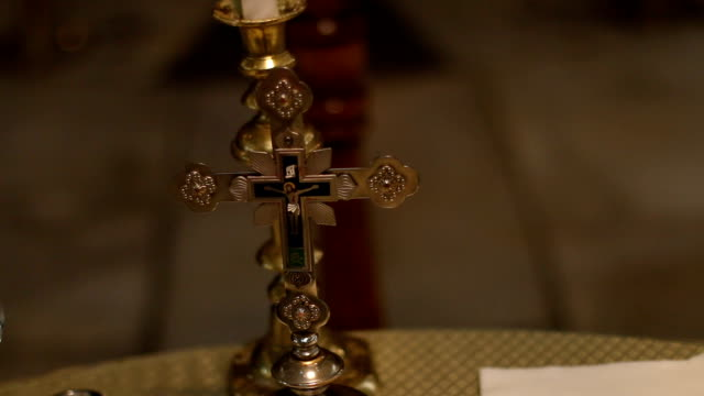 Cross on altar in church video