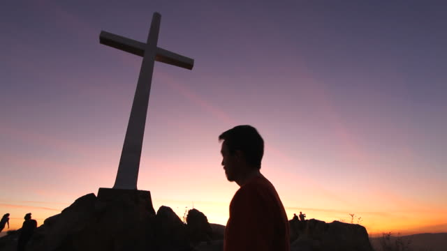 Cross on Hill Man Prays video
