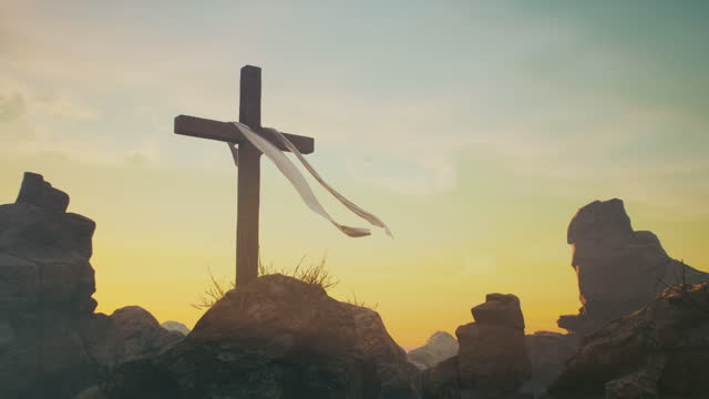 Cross on Jesus Christ grave Zoom out view of wooden cross with fluttering cloth placed on rocks against blue sky on day of Jesus Christ resurrection on Golgotha in Jerusalem religion stock videos & royalty-free footage