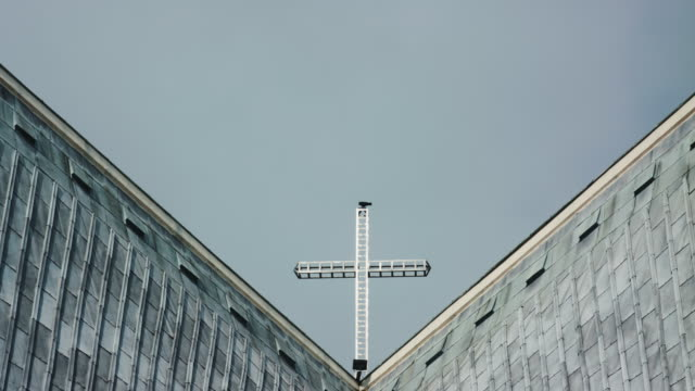 Cross On Top Of Church Against Clear Sky video