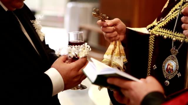 Cross priest consecrates glass of wine video