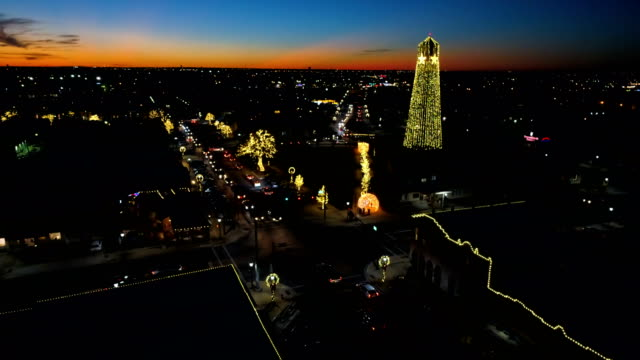 Cross streets and colorful Christmas lights line the street Aerial drone views of Christmas in Round Rock Texas