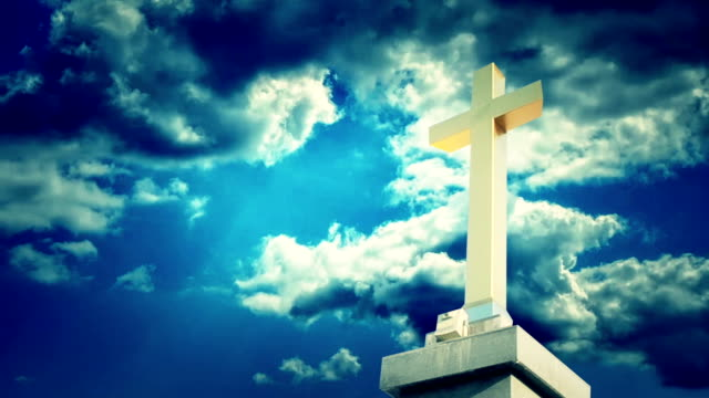 Cross with time lapse clouds. video