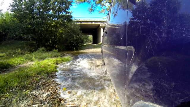 Crossing stream on a car. video