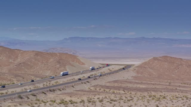 I-15 Crossing the Mojave Desert - Drone Shot Drone shot of Interstate 15, a divided highway crossing the Mojave Desert near the town of Zzyzx. mojave desert stock videos & royalty-free footage