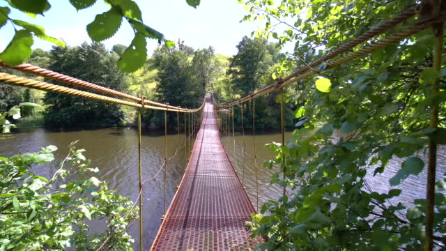 crossing the suspension bridge over the river video