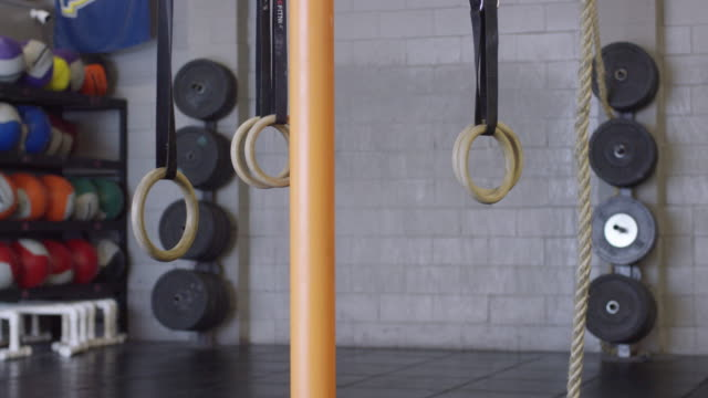 Cross-Training Equipment In an Empty Gym Gimbal shot of cross-training equipment in a gym health club stock videos & royalty-free footage