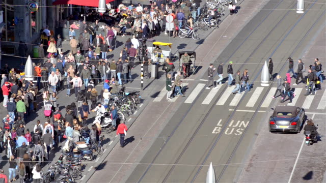 crosswalk with pedestrians aerial view - dutch architecture stock videos & royalty-free footage