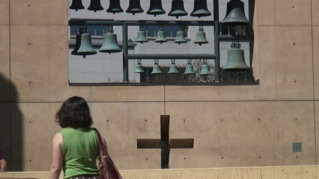 (HD1080i) CrossWalk: Woman Walks to Reveal Cross in Wall video