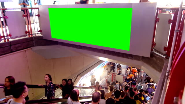 crowd at electric sky train station with green screen billboard crowd of people on escalator at public electric sky train station with green screen billboard underground stock videos & royalty-free footage
