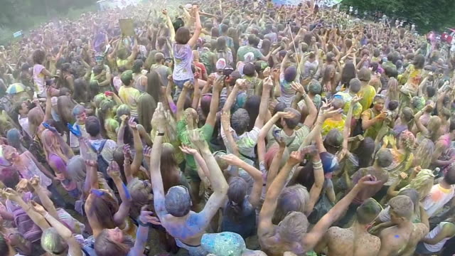Crowd covered in colored powder paint, festival atmosphere video