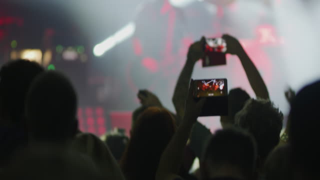 ms crowd dancing and filming music concert - attività del fine settimana video stock e b–roll