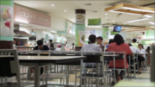 crowd if people in the supermarket - stołówka filmów i materiałów b-roll