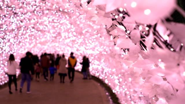 stockvideo's en b-roll-footage met menigte in winterseizoen met roze licht verlichting 's nachts in de winter nagoya, japan. - boog architectonisch element