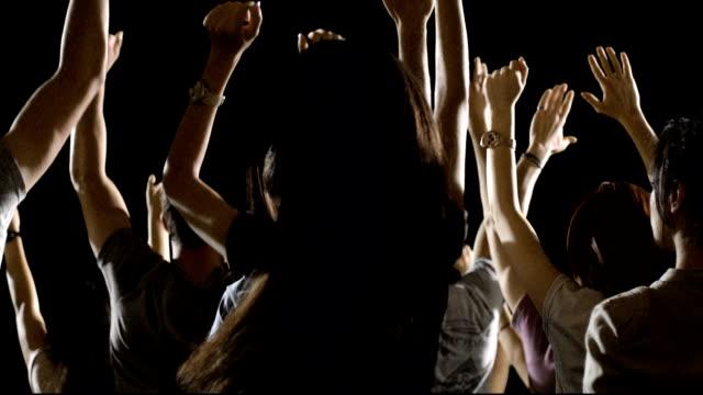 Crowd of fans dancing on black background . Concert, jumping, Dancing. Slow motion. Shot on RED EPIC Cinema Camera. video