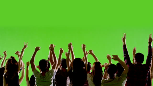 crowd of fans dancing on green screen. concert, jumping, dancing. slow motion. shot on red epic cinema camera. - chroma key bildbanksvideor och videomaterial från bakom kulisserna