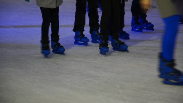 crowd of Ice skaters at a public ice skating rink, Medium Shot, Front and side View video
