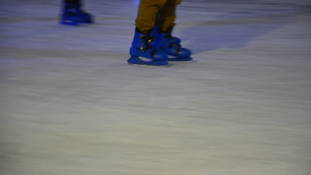 crowd of Ice skaters at a public ice skating rink, Medium Shot, Side View video