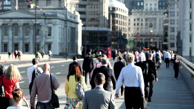 Crowd of pedestrian commuters on London Bridge in focus video