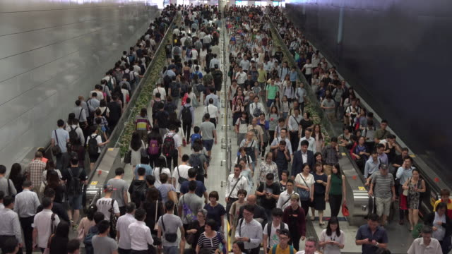 Crowd of pedestrian commuters on train station at Hong kong station Crowd of pedestrian commuters on train station at Hong kong station underground stock videos & royalty-free footage