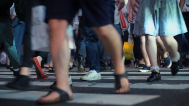 Crowd of Pedestrians / People Crossing / Walking Throught Crosswalk in the Big City. Focus on the Legs. Crowd of Pedestrians / People Crossing / Walking Throught Crosswalk in the Big City. Focus on the Legs. Shot on 4K UHD Camera. stepping stock videos & royalty-free footage