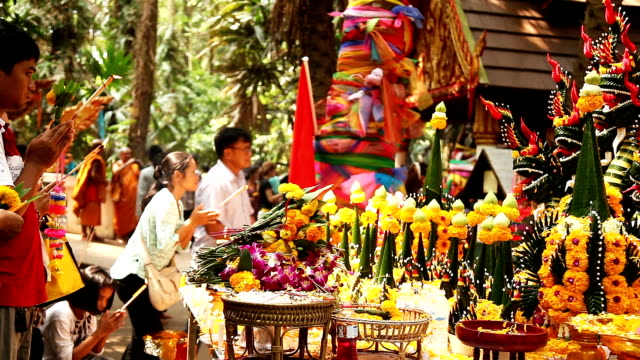 Crowd of people come and pray for good luck at Wat Pa Kham Chanod video
