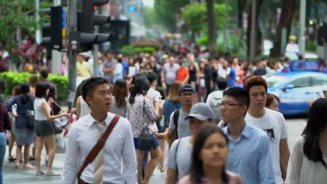 Crowd of people cross Orchard Road video