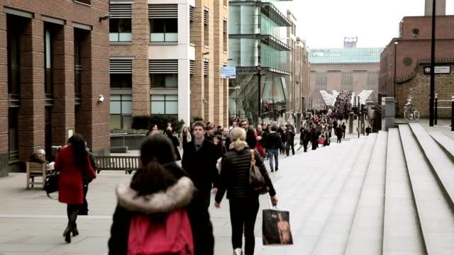 crowd of people crossing Millenium Bridge video