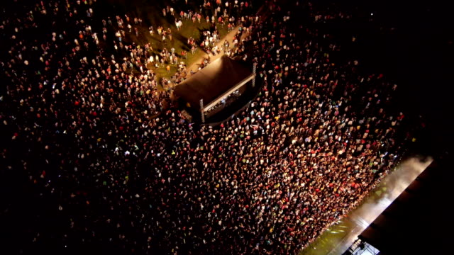 AERIAL: Crowd of people dancing on a music festival AERIAL: Crowd of people dancing on a music festival rock music stock videos & royalty-free footage