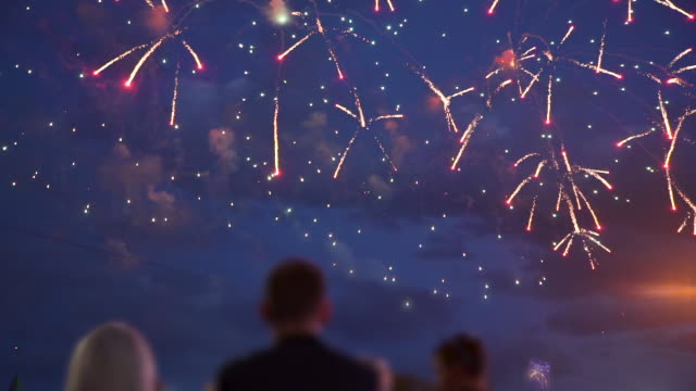 crowd of people look at the fireworks - petardo video stock e b–roll