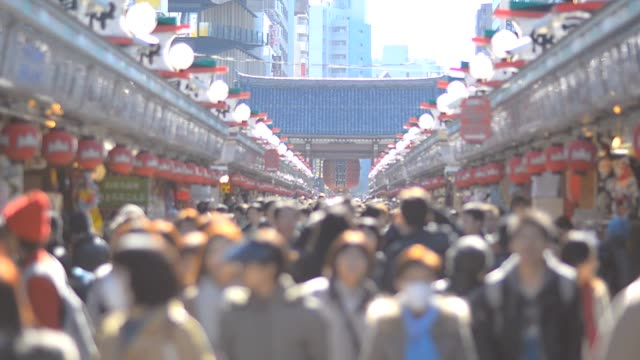 crowd of people on street market video