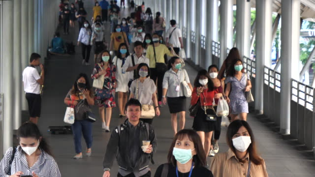 crowd of people using surgical mask in lifestyle working - mask surgery video stock e b–roll