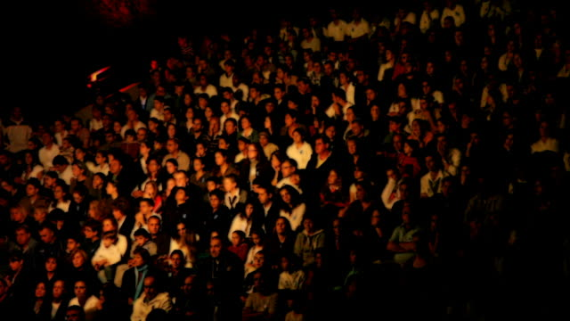 Crowd of people waiting for the concert beginning video