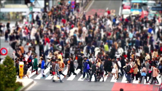 Crowd of people walking across the Shibuya crossing in Tokyo