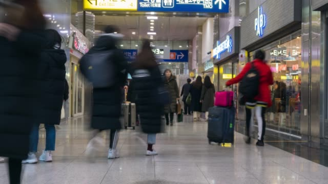 crowd of people walking in station at south korea - adulazione video stock e b–roll