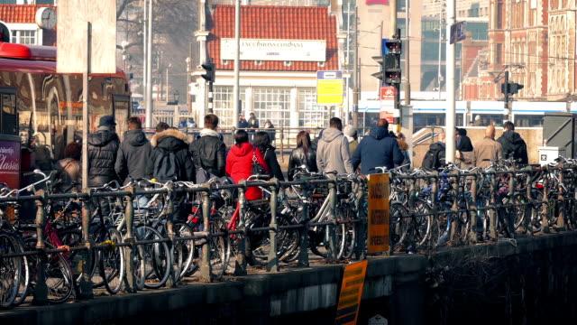 Crowd of People Walking Past Bikes In City video