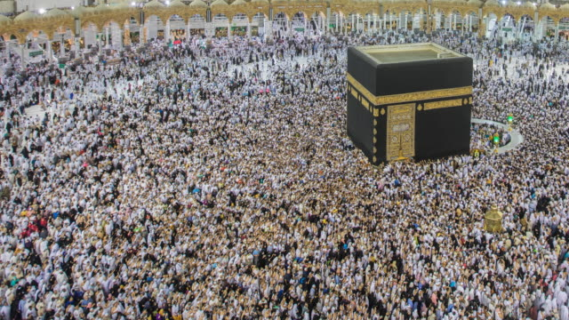 crowd of pilgrims circumambulate around kaaba - ramadan stock videos and b-roll footage