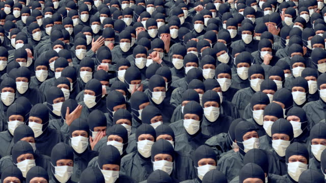 A crowd of sick people in medical masks coughing and sneezing. video