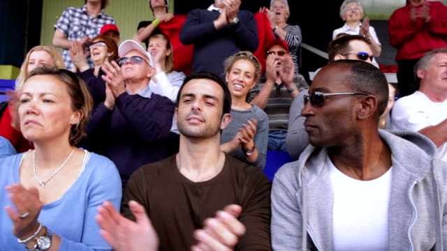 Crowd of sports spectators clapping video