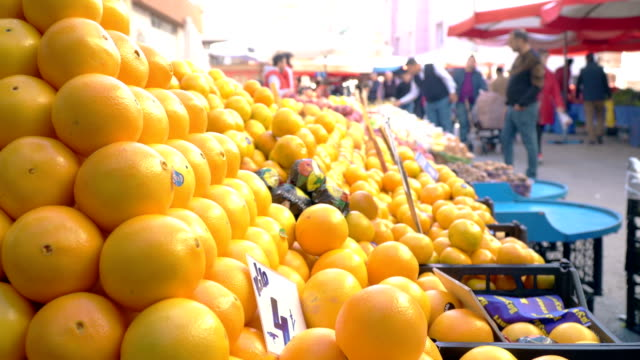 Crowd on Farmer's Market with Oranges