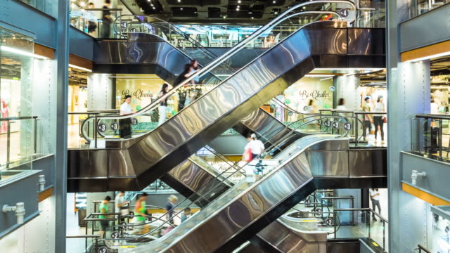 crowd people in shopping mall - escalator video stock e b–roll