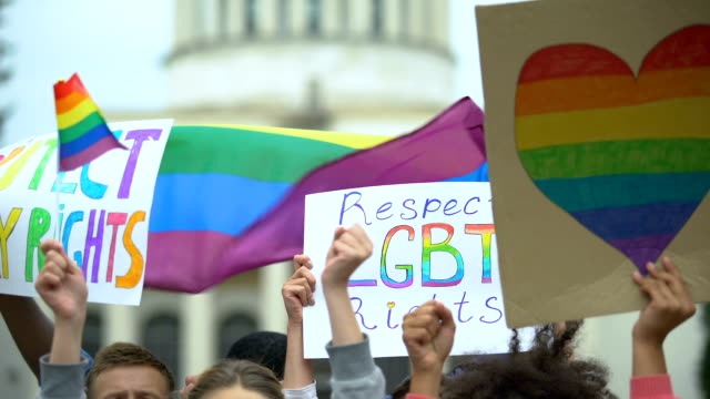 Crowd raising posters chanting to respect LGBT rights, support for gay marriage Crowd raising posters chanting to respect LGBT rights, support for gay marriage lgbtqi rights stock videos & royalty-free footage