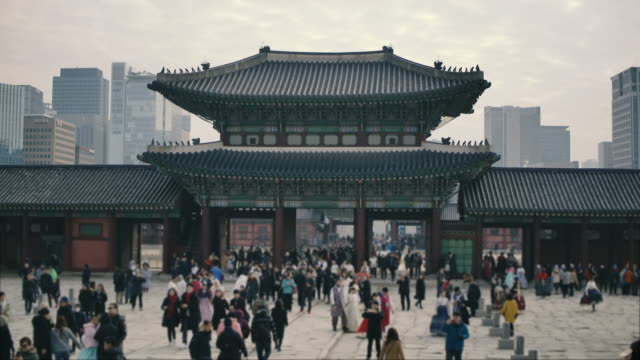 Crowd travel to Gyeongbokgung Palace in Seoul, South Korea. Crowd travel to Gyeongbokgung Palace in Seoul, South Korea. south korea stock videos & royalty-free footage