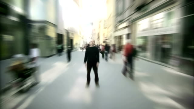 Crowd walking around frustrated man Time lapse video
