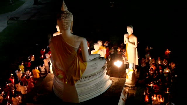 Crowd walking with Candle Light around Wat Wai Whaimongkol video