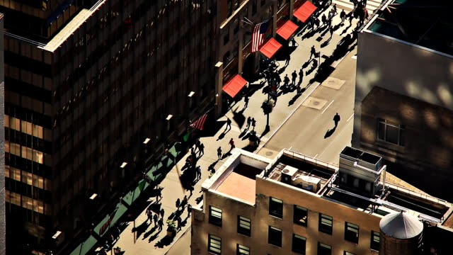 Crowded city street form above video