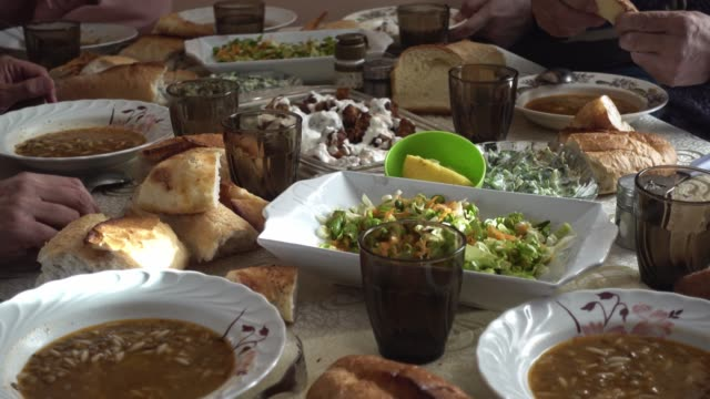 crowded muslim family eating vegan food and having iftar in a ramadan day - cultura turca video stock e b–roll