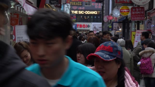 crowded of people walking in the streets of seoul, south korea - seoul video stock e b–roll
